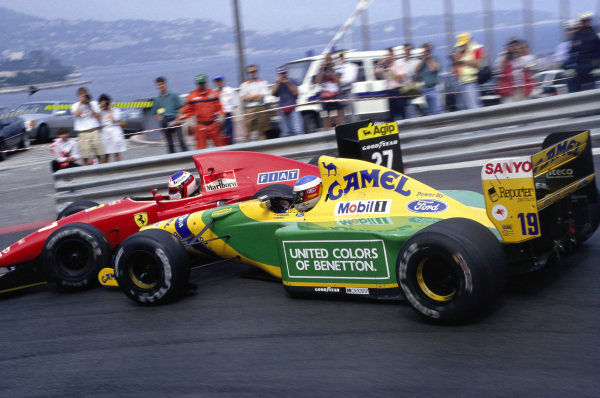 Michael Schumacher, Benetton B192 Ford, collides with Jean Alesi, Ferrari F92A, at the hairpin.
