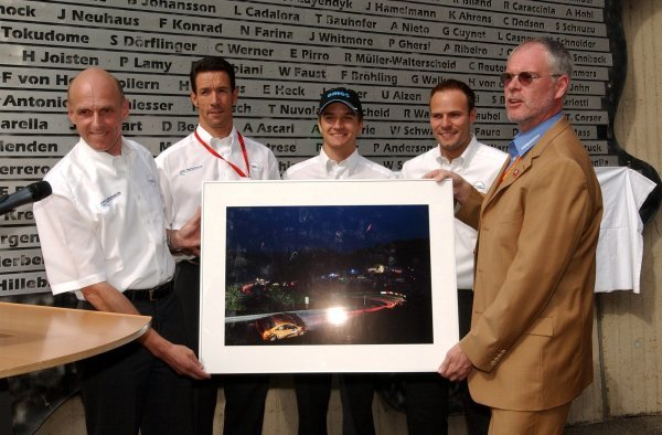 Volker Strycek (GER), Opel Motosport Director, hands over a photo to Dr. Walter Kafitz (GER), Chief Executive Officer Nürburgring GmbH, to remember the Opel victory. In the back the other winner drivers, from left to right: Manuel Reuter (GER), OPC Team Holzer, Timo Scheider (GER), OPC Team Phoenix, and Marcel Tiemann (GER). Revealing of the winners names of the Nürburgring 24Hrs race. DTM Championship, Rd 7, Nürburgring, Germany. 16 August 2003. DIGITAL IMAGE