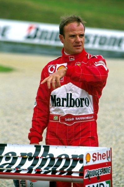 Rubens Barrichello (BRA) with his stranded Ferrari F2002 in the gravel trap. Austrian Grand Prix, Rd6, A1-Ring, Austria. 13 May 2002. BEST IMAGE