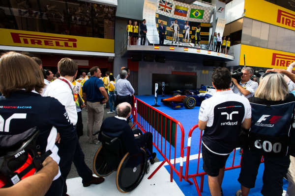 2014 GP2 Series Round 2 - Race 1. Circuit de Catalunya, Barcelona, Spain. Saturday 10 May 2014. Frank Williams watch the GP2 podium Photo: Malcolm Griffiths/GP2 Series Media Service. ref: Digital Image F80P2179