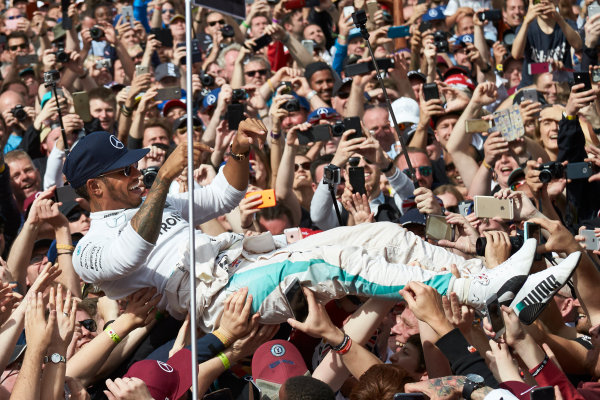 Silverstone, Northamptonshire, UK Sunday 10 July 2016. Lewis Hamilton, Mercedes AMG, 1st Position, celebrates with some crowd surfing after the race. World Copyright: Steve Etherington/LAT Photographic ref: Digital Image SNE21959