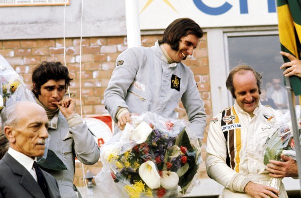 The podium (L to R): Francois Cevert (FRA) Tyrrell second place; Emerson Fittipaldi (BRA) Lotus race winner; Denny Hulme (NZL) McLaren third.