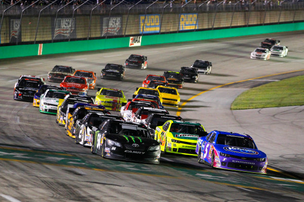 26-27 June, 2014, Sparta, Kentucky USA Kyle Busch, Monster Energy Toyota Camry and Kevin Harvick restart ?2014, Russell LaBounty LAT Photo USA