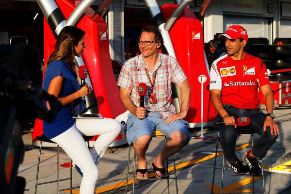 Hungaroring, Budapest, Hungary. Friday 25 July 2014. Jacques Villeneuve and Marc Gene, Ferrari. World Copyright: Steven Tee/LAT Photographic. ref: Digital Image _L4R8359