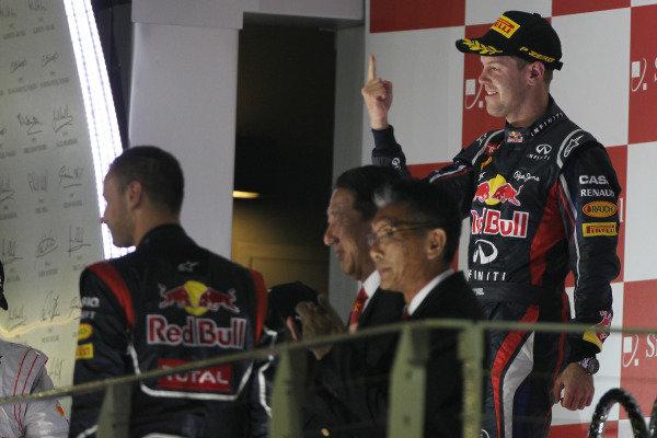 Marina Bay Circuit, Singapore23rd September 2012Sebastian Vettel, Red Bull Racing, 1st position, celebrates on the podium.World Copyright: Andy Hone/LAT Photographicref: Digital Image HONY9475