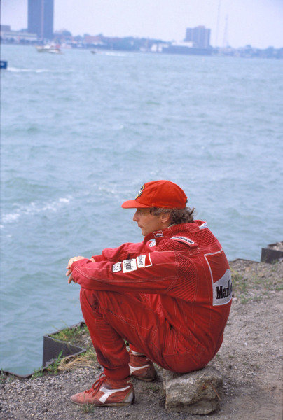 Niki Lauda sits looking out across the river having retired from the race.