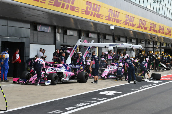 Lance Stroll, Racing Point RP19, and Sergio Perez, Racing Point RP19, in the pits during practice