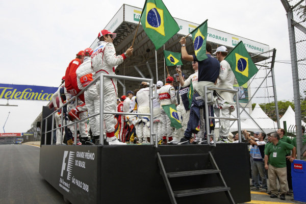 The drivers wave with the Brazilian national flag from the drivers' parade truck.