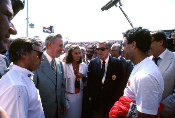Bernie Ecclestone (Left) Head of FOCA and Brabham team owner helped orchestrate the first ever Formula One race in the Eastern Bloc. With him includes FISA President Jean-Marie Balestre (centre) and Michele Alboreto (ITA) Ferrari. Hungarian Grand Prix, Hungaroring, 10 August 1986.