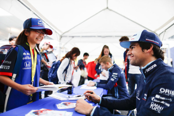 Lance Stroll, Williams Racing, signs an autograph for a fan