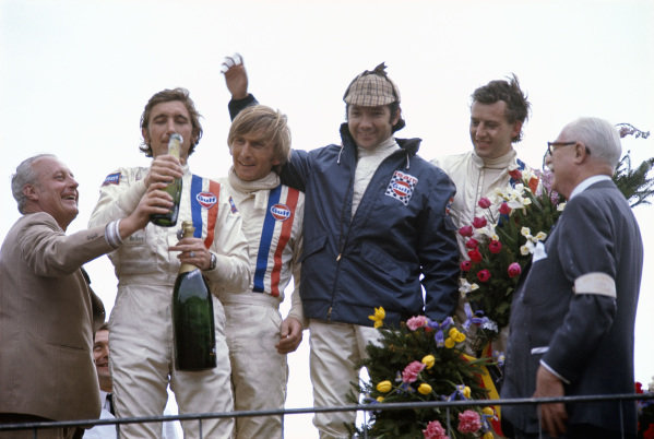 The two winning Porsche driver teams: Jo Siffert, Derek Bell, Pedro Rodriguez and Jackie Oliver celebrate on the podium.