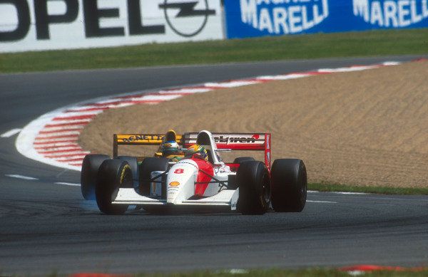 1993 French Grand Prix.Magny-Cours, France.2-4 July 1993.Ayrton Senna (McLaren MP4/8 Ford) with Michael Schumacher (Benetton B193B Ford) close behind.Ref-93 FRA 04.World Copyright - LAT Photographic
