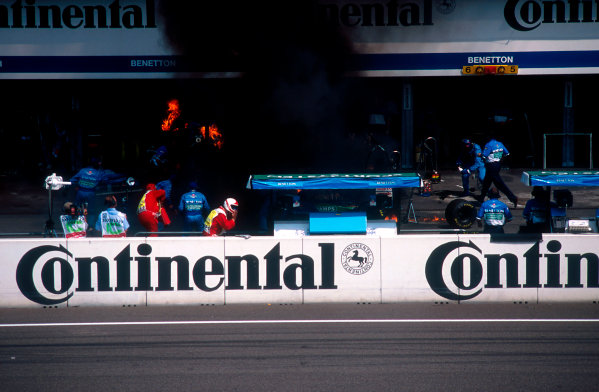 1994 German Grand Prix.Hockenheim, Germany.29-31 July 1994.Jos Verstappen (Benetton B194 Ford) came in for his pitstop. As the Refueller pulled the fuel hose away the valve stuck open allowing fuel to still come out of the nozzle and over the car which ignited into a huge fireball. The fire was delt with quite swiftly though.Ref-94 GER 46.World Copyright - LAT Photographic