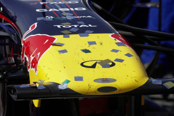 Confetti on the tip of the nose of a Red Bull RB7 Renault.