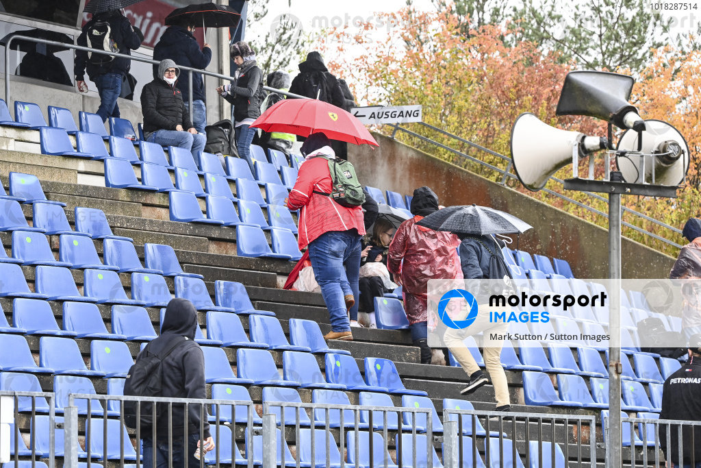 Fans in a grandstand with waterproofs on