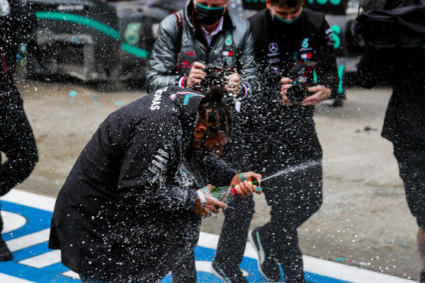 Lewis Hamilton, Mercedes-AMG Petronas F1, 1st position, and the Mercedes team celebrate with champagne after having secured a seventh world drivers championship title