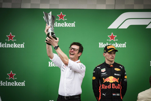 Andrew Shovlin, Chief Race Engineer, Mercedes AMG, lifts the Constructors trophy alongside Max Verstappen, Red Bull Racing, 2nd position
