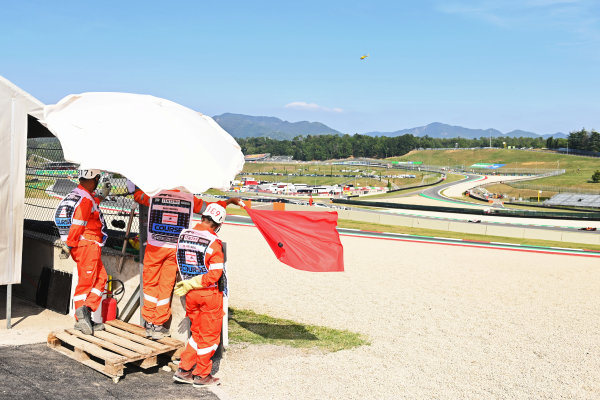 Marshals wave the red flag from their post in FP2