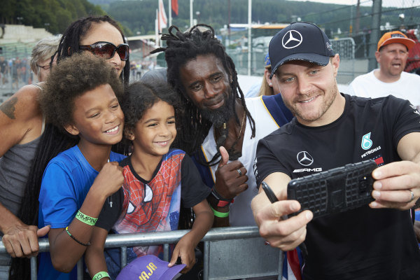 Valtteri Bottas, Mercedes AMG F1, signs autographs for fans and poses for pictures
