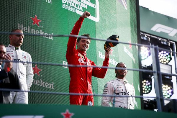 Valtteri Bottas, Mercedes AMG F1, 2nd position, Charles Leclerc, Ferrari, 1st position, and Lewis Hamilton, Mercedes AMG F1, 3rd position, on the podium