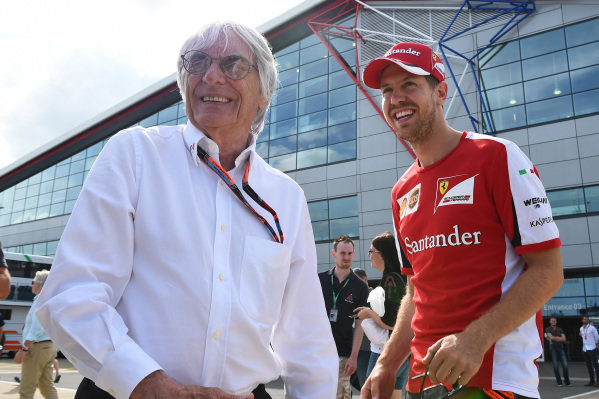 Bernie Ecclestone (GBR) CEO Formula One Group (FOM) talks with Sebastian Vettel (GER) Ferrari at Formula One World Championship, Rd9, British Grand Prix, Qualifying, Silverstone, England, Saturday 4 July 2015.