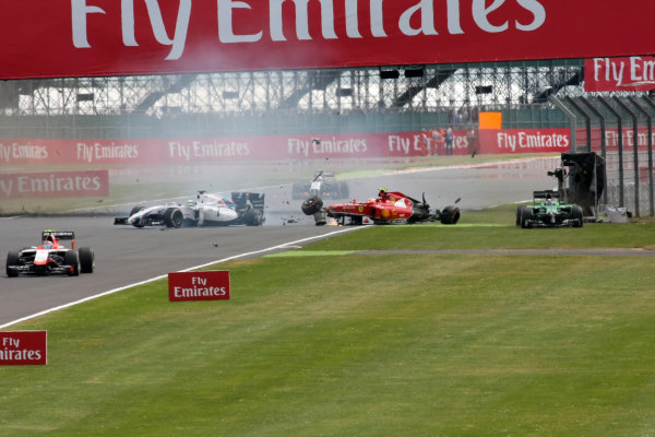 Kimi Raikkonen (FIN) Ferrari F14 T crashed on lap one and was collected by Felipe Massa (BRA) Williams FW36, bringing out the red flag for barrier repairs. Formula One World Championship, Rd9, British Grand Prix, Race Day, Silverstone, England, Sunday 6 July 2014. BEST IMAGE