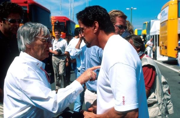 Bernie Ecclestone(GBR) F1 Supremo makes a point to Sylvester Stallone Hungarian GP, Hungaroring, 15 August 1999