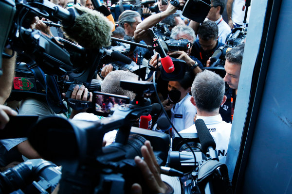 Autodromo Nazionale di Monza, Monza, Italy. Sunday 6 September 2015. Paddy Lowe, Executive Director (Technical), Mercedes AMG, is swamped by the press as he leaves an FIA stewards enquiry concerning Mercedes' tyre pressures. World Copyright: Jed Leicester/LAT Photographic ref: Digital Image _L2_9551