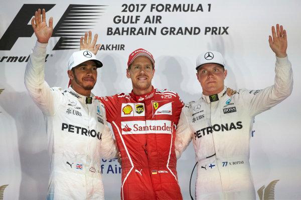 Bahrain International Circuit, Sakhir, Bahrain.  Sunday 16 April 2017. Lewis Hamilton, Mercedes AMG, 2nd Position, Sebastian Vettel, Ferrari, 1st Position, and Valtteri Bottas, Mercedes AMG, 3rd Position, on the podium. World Copyright: Steve Etherington/LAT Images ref: Digital Image SNE23064