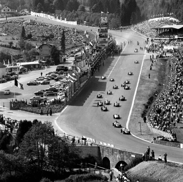 1958 Belgian Grand Prix. Spa-Francorchamps, Belgium. 13-15 June 1958. The field enters Eau Rouge at the start. The race was won by Tony Brooks in a Vanwall. Ref-2134. World Copyright - LAT Photographic