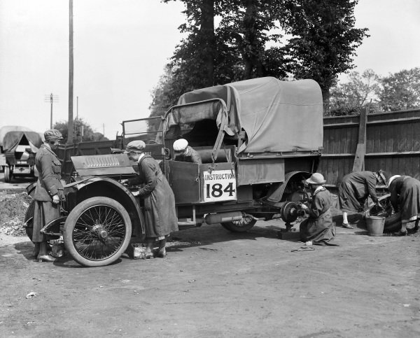 Women's Royal Air Force recruits carry out a service on a Crossley lorry under supervision from an officer, during their training to become transport drivers.