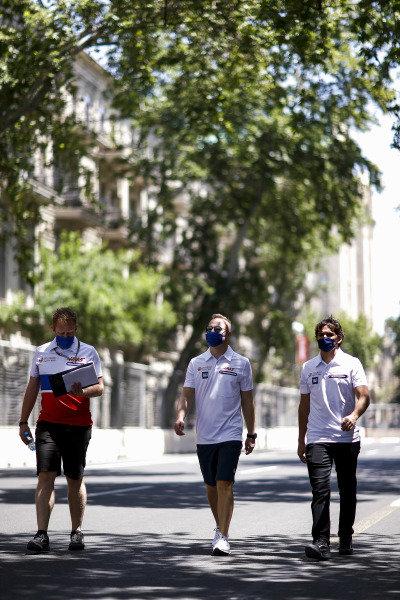 Nikita Mazepin, Haas F1 and Pietro Fittipaldi, reserve driver, Haas F1 walks the track