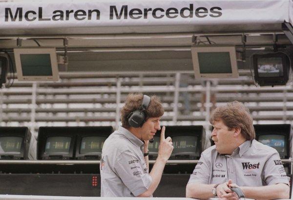 1998 Brazilian Grand Prix.Interlagos, Sao Paulo, Brazil.27-29 March 1998.Mario Illien (Ilmor Engineering) with Norbert Haug (Daimler-Benz Motorsport).World Copyright - LAT Photographic