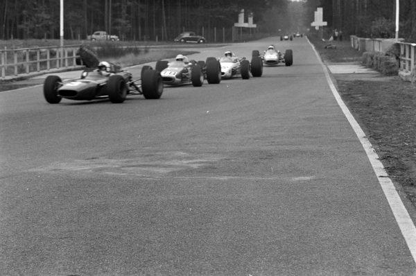 Chris Amon, Ferrari Dino 166, leads Jo Schlesser, McLaren M4A Cosworth, and Robin Widdows, McLaren M4A Cosworth.