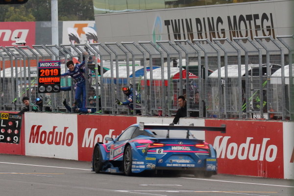 Second position in GT500 and 2019 Drivers' champions Kazuya Oshima & Kenta Yamashita, Lexus Team Le Mans Wako's Lexus 4CR LC500, are greeted by their team at the finish