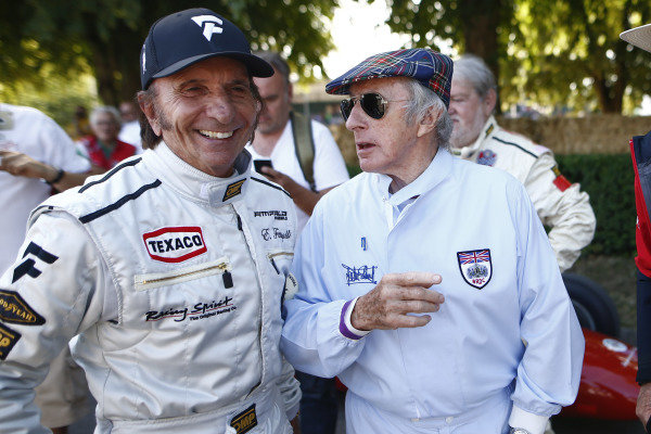 Emerson Fittipaldi and Sir Jackie Stewart in the holding area