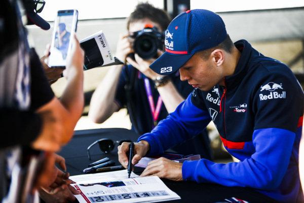 Alexander Albon, Toro Rosso signs autographs for fans