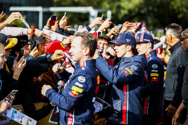 Christian Horner, Team Principal, Red Bull Racing, Pierre Gasly, Red Bull Racing and Max Verstappen, Red Bull Racing sign a autographs for fans at the Federation Square event