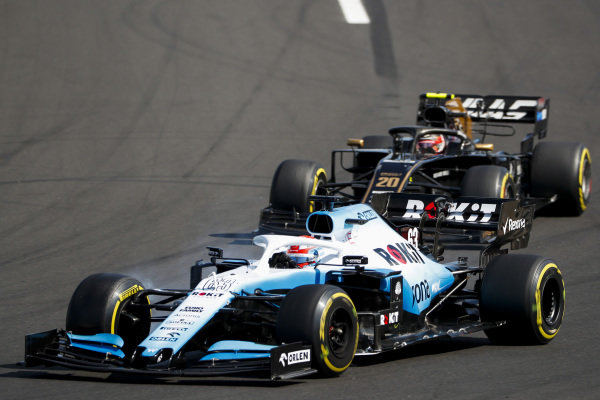 George Russell, Williams Racing FW42, leads Kevin Magnussen, Haas VF-19