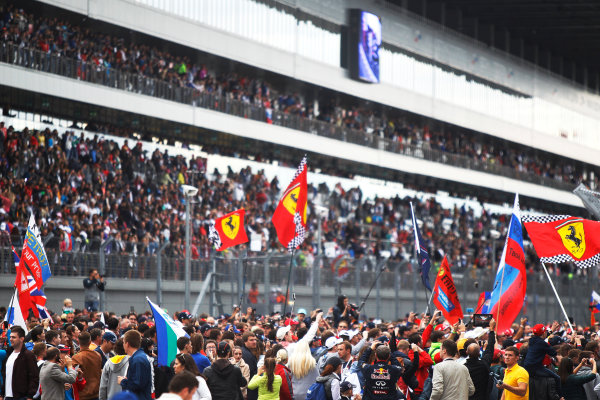 Sochi Autodrom, Sochi, Russia. Sunday 11 October 2015. Fans invade the circuit to celebrate after the race. World Copyright: Sam Bloxham/LAT Photographic ref: Digital Image _G7C8081