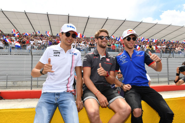 Esteban Ocon (FRA) Force India F1, Romain Grosjean (FRA) Haas F1 and Pierre Gasly (FRA) Scuderia Toro Rosso