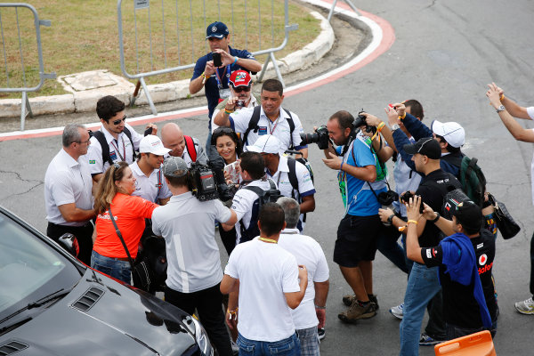 Interlagos, Sao Paulo, Brazil. Sunday 9 November 2014. Felipe Massa, Williams F1, poses for photos with fans. World Copyright: Charles Coates/LAT Photographic. ref: Digital Image _J5R5246