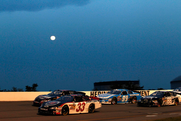24 July, 2010, Indianapolis, Indiana, USARon Hornaday and Kyle Busch race with the moon©2010, Michael L. Levitt, USALAT Photographic