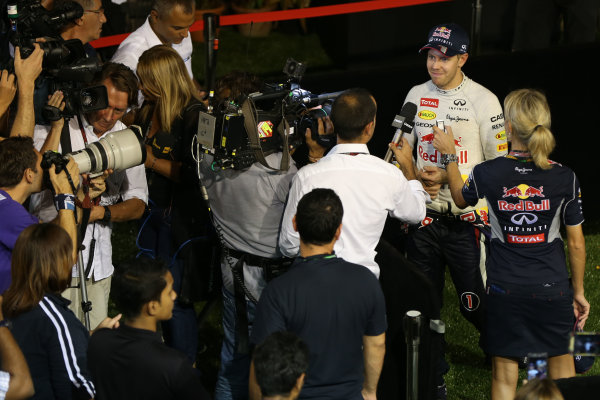 Marina Bay Circuit, Singapore. Sunday 22nd September 2013.  Sebastian Vettel, Red Bull Racing, talks to the media.  World Copyright: Andy Hone/LAT Photographic. ref: Digital Image HONZ6119