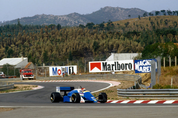 1987 Portuguese Grand Prix.  Estoril, Portugal. 18-20 September 1987.  Alex Caffi, Osella FA1I Alfa Romeo.  Ref: 87POR30. World Copyright: LAT Photographic