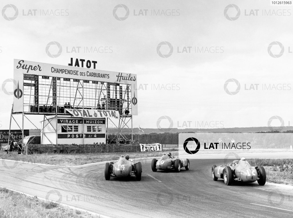 Reims, France. 1 July 1956.Juan Manuel Fangio (Lancia-Ferrari D50), 4th position, leads Eugenio Castellotti (Lancia-Ferrari D50), 2nd position, Peter Collins (Lancia-Ferrari D50), 1st position, and Harry Schell (Vanwall VW2), 10th position, action.World Copyright: LAT PhotographicRef: Autocar Glass Plate C47536