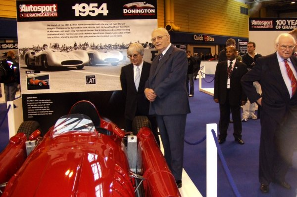2006 Autosport International Birmingham NEC, Friday 13th January 2006. Bernie Ecclestone, Tom Wheatcroft and Prof. Sid Watkins admire the Lancia D50 in the LAT/Donington GP Collection exhibition. World Copyright: Fiona Fallon/LAT Photographic ref: Digital Image Only