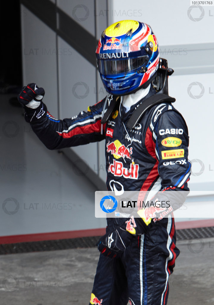 Interlagos, Sao Paulo, Brazil. 27th November 2011. Mark Webber, Red Bull Racing RB7 Renault, 1st position, celebrates victory in Parc Ferme. Portrait. Helmets. Finish.  World Copyright: Steve Etherington/LAT Photographic ref: Digital Image SNE28281
