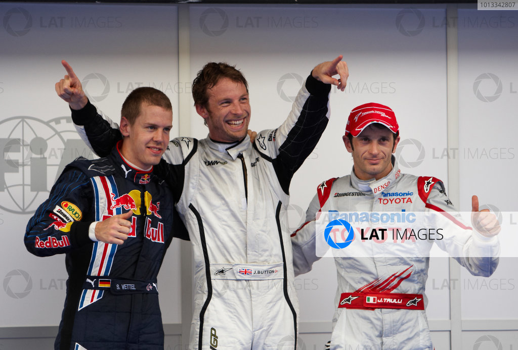 Sepang, Kuala Lumpur, Malaysia 4th April 2009 Top three finishers Jenson Button, Brawn GP BGP001 Mercedes, Jarno Trulli, Toyota TF109, and Sebastian Vettel, Red Bull Racing RB5 Renault. Portrait.   World Copyright: Steve Etherington/LAT Photographic ref: Digital Image SNE13775