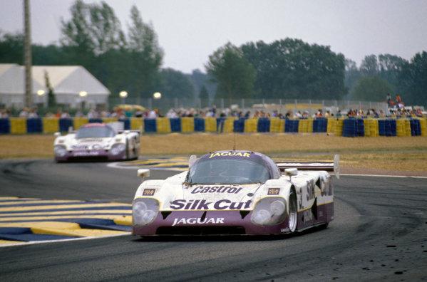Le Mans, France. 16th - 17th June 1990. John Nielsen/Price Cobb/Eliseo Salazar/Martin Brundle (Jaguar XJR-12), 1st position, leads Jan Lammers/Andy Wallace/Franz Konrad (XJR-12), 2nd position, action.  World Copyright: LAT Photographic. Ref:  90LM